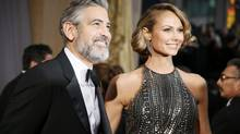 George Clooney, producer of best picture nominated film Argo, arrives at the 85th Academy Awards with his girlfriend Stacy Keibler, on Feb. 24, 2013. An upcoming Disney film starring Mr. Clooney will be shot in Vancouver. (LUCY NICHOLSON/REUTERS)