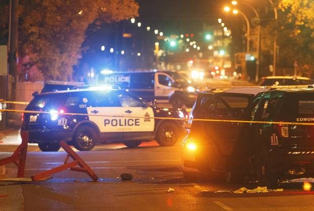 Police investigate the scene where a car crashed into a roadblock in Edmonton on Sept. 30, 2017.