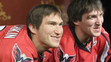 sia's Alex Ovechkin (R), star forward for the Washington Capitals of the NHL, smiles with his wax likeness in hockey gear at Madame Tussauds wax museum in Washington, October 24, 2011. REUTERS/Jonathan Ernst (Jonathan Ernst/Reuters)