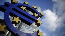 The Euro currency sign is seen in front of the European Central Bank headquarters in Frankfurt. (Lisi Niesner/Reuters)