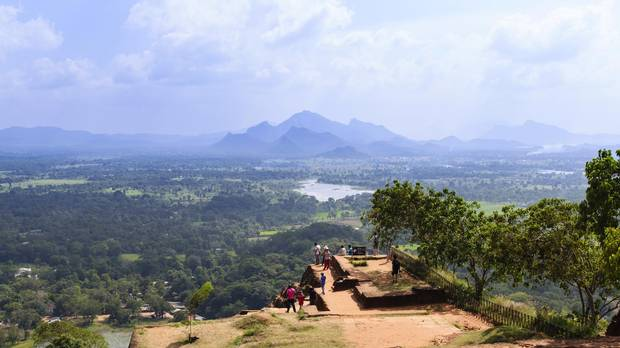 Tourists take in the view from the top of Sigiriya rock in Sri Lanka.
