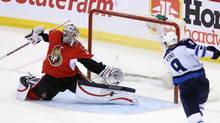 Ottawa Senators goaltender Robin Lehner (40) makes a pad save on a shot by Winnipeg jets Evander Kane (9)during third period NHL action Ottawa Senators and the Winnipeg jets in Ottawa Sunday March 17, 2013. (FRED CHARTRAND/THE CANADIAN PRESS)