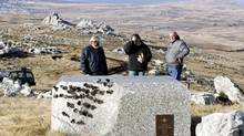 Visitors look at commemorative plaques for British soldiers who died during the 1982 Falklands War (Guerra de Las Malvinas) in Mount Longdon, near Port Stanley, capital of the Falkland Islands, in this file photo taken June 10, 2007. (ENRIQUE MARCARIAN/REUTERS)