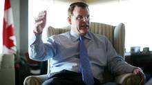 Foreign Affairs Minister John Baird gestures during an interview in his office in Ottawa. (Dave Chan for The Globe and Mail)
