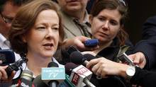 Alberta Premier Alison Redford, left, scrums with the media following her meeting with B.C. Premier Christy Clark to discuss the Northern Gateway pipeline in October 2012. (Jeff McIntosh/The Canadian Press)