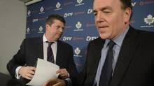 Dave Nonis, left, seemed less than enthused at a news conference with and MLSE president Tom Anselmi in Toronto on Wednesday. Nonis inherits Brian Burke's full portfolio with the Maple Leafs. (Fred Lum/The Globe and Mail)