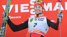 Canada's Alex Harvey celebrates on the podium (Alik Keplicz/The Associated Press)