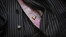 New suits from Garrison's tailors, lined with ultra thin sheets of carbon nanotubes, should be able to withstand bullets from a 9 mm gun. (MARK BLINCH FOR THE GLOBE AND MAIL)