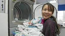 "Rody Shakhel does her laundry regularly at the recently opened laundromat ""Quick Clean"" in Satya Vihar, New Delhi. Quick Clean is the first laundromat in India. (Lana Slezic/Lana Slezic)"