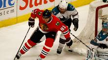 Marian Hossa #81 of the Chicago Blackhawks moves the puck around the net against Douglas Murray #3 of the San Jose Sharks in the first period in Game Three of the Western Conference Finals during the 2010 NHL Stanley Cup Playoffs at the United Center on May 21, 2010 in Chicago, Illinois. (Photo by Jonathan Daniel/Getty Images) (Jonathan Daniel/2010 Getty Images)