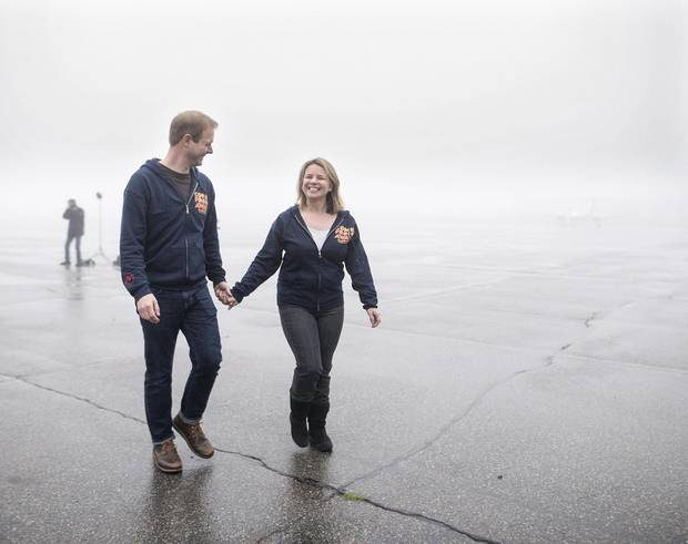 David Hein, left, and Irene Sankoff, the husband-and-wife writing team behind the musical Come From Away, hold hands walking off the tarmac at the Gander International Airport in Gander, N.L. on Sunday, October 30, 2016. Darren Calabrese/The Globe and Mail