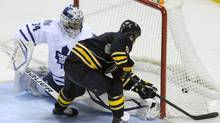 Buffalo Sabres center Steve Ott (9) scores on Toronto Maple Leafs goaltender James Reimer during the shootout of an NHL hockey game in Buffalo, N.Y., Thursday, March 21, 2013. Buffalo won 5-4. (AP)