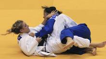 Kelita Zupancic (L) of Canada challenges Yoriko Kunihara of Japan during their women's under 70 kg semifinal at the IJF Grand Slam judo tournament in Rio de Janeiro June 19, 2011. (Sergio Moraes/Reuters/Sergio Moraes/Reuters)