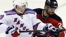 New York Rangers' Chris Kreider, left, struggles with New Jersey Devils' Bryce Salvador as Devils goalie Martin Brodeur blocks a shot during the second period of Game 4 of an NHL hockey Stanley Cup Eastern Conference final playoff series, Monday, May 21, 2012, in Newark, N.J. (AP Photo/Kathy Willens) (Kathy Willens/AP)