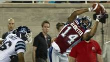 Montreal Alouettes wide receiver Brandon London hauls in a pass ahead of Toronto Argonauts safety Jordan Younger during fourth quarter CFL football action Friday, July 27, 2012 in Montreal. (The Canadian Press)