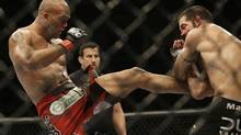 Robbie Lawler, left, kicks Matt Brown during the fifth round of a welterweight mixed martial arts bout at a UFC event in San Jose, Calif., Saturday, July 26. (Jeff Chiu/AP)