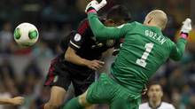 Mexico's Jesus ZaVala, left , tries a header as United States' goalkeeper Brad Guzan blocks him during a World Cup 2014 qualifying match at the Aztec stadium in Mexico City, Tuesday, March 26, 2013. (Christian Palma/AP)