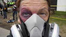 A protester sports a fake black eye and a mask during a demonstration against tuition-fee hikes in Montreal on April 26, 2012. (Ryan Remiorz/Ryan Remiorz/The Canadian Press)