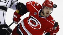 Carolina Hurricanes' Tuomo Ruutu reaches for the puck against the Los Angeles Kings during the third period of an NHL hockey game in Raleigh, N.C., Saturday, Feb. 4, 2012. (Gerry Broome/Associated Press)