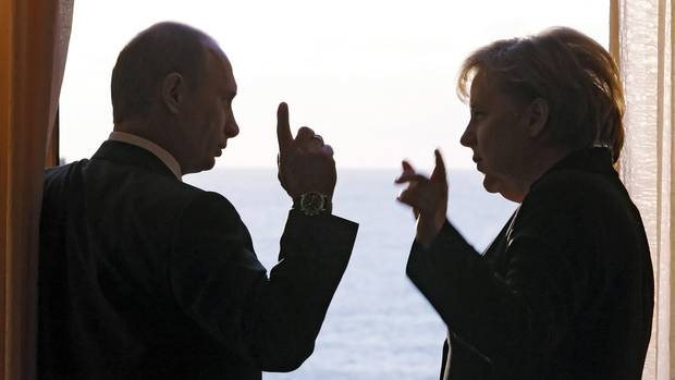 Russian President Vladimir Putin talks with Ms. Merkel during a meeting at the Russian presidential residence on Jan. 21, 2007.