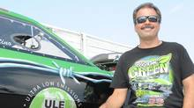 Eric Latino, founder of Global Emissions Systems, and his Green Team race car. (Dave Erauw/Dave Erauw)