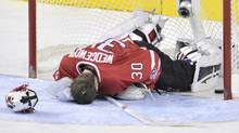 Team Canada goaltender Scott Wedgewood lies in front of his net following a goal by Team Russia on Tuesday January 3, 2012. (Nathan Denette/THE CANADIAN PRESS/Nathan Denette/THE CANADIAN PRESS)