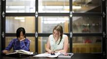 Sophie Guo, left, and Jamie Picken study during summer school in Vancouver. (Rafal Gerszak/The Globe and Mail)