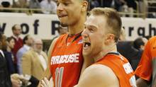 Syracuse Orange guard Tyler Ennis, left, and guard Trevor Cooney celebrate a victory against the Pittsburgh Panthers at the Petersen Events in Pittsburgh on Feb. 12. (Charles LeClaire/USA Today Sports)