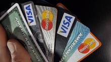 Shopping and swiping your credit card could leave you at risk for fraud. So can dining and paying for your meal with a swipe of your credit card. (Elise Amendola/The Associated Press)