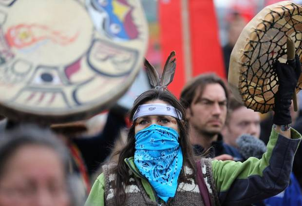 First Nations protester Ceci Point of the Musqueam Band marches against the proposed expansion of Kinder Morgan's Trans Mountain Pipeline in Vancouver, B.C. on Nov. 19, 2016.
