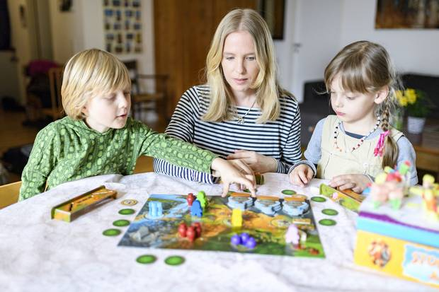 Meike Joa is seen with her children at home in Frankfurt, Germany. German women's employment rates have made gains in recent years as Canadian women's progress into working life has stalled.
