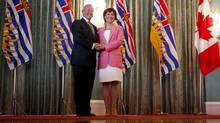 B.C. Minister of Education Peter Fassbender shakes hands with Premier Christy Clark after they were officially sworn in in Victoria on June 10, 2013. (Chad Hipolito for The Globe and Mail)