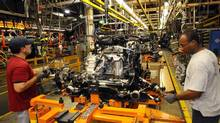 Workers assemble a vehicle at Ford Motor Co.'s Oakville plant. (FORD MOTOR CO./THE CANADIAN PRESS)