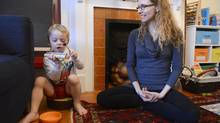 Sara Marlowe includes her three-year-old son Beckett in her practice of mindfulness, which encourages being in the moment. (Fred Lum/The Globe and Mail)