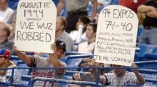 Two Montreal Expos fans remember the strike of 1994 before the game between the Expos and the Arizona Diamondbacks in August 2004 (FRANCOIS ROY/Canadian Press)