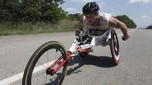 Canadian Paralympic athlete Josh Cassidy trains in his racing wheelchair in the Oakville area on June 20, 2012 (Deborah Baic/The Globe and Mail)
