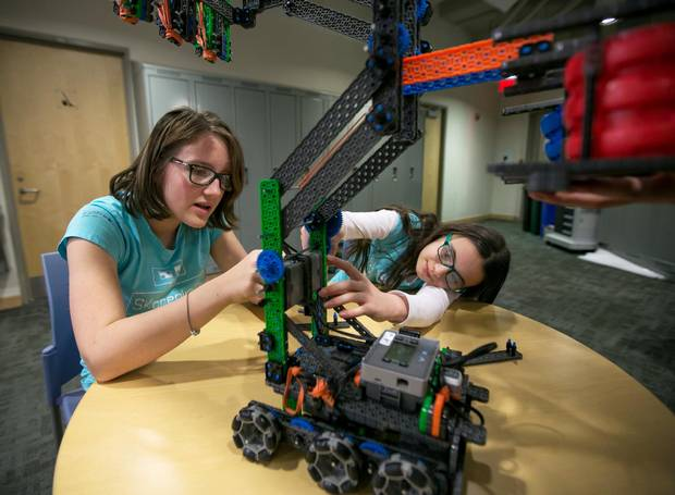 Katrina Usmar, left, and Samantha Sedran, students from St. Clement's School in Toronto, work on their robot Hexie in preparation for the upcoming Vex IQ Challenge Ringmaster.
