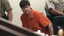 Justin Ross Harris, 33, looks on at the Cobb County Magistrate Court in Marietta, Ga., on July 3, 2014. The suburban Atlanta man who prosecutors said intentionally left his 22-month-old son strapped inside a hot car to die because he wanted to live a child-free life will remain jailed pending his trial, a judge ruled on Thursday. (KELLY HUFF/REUTERS)