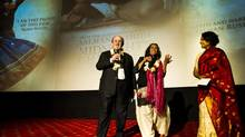 Salman Rushdie, Deepa Mehta and Seema Biswas on stage at the premiere of Midnight's Children at the PVR Plaza Cinema in Connaught Place in New Delhi, India on the 22nd January 2013 (Simon de Trey-White/S de Trey-White)