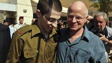 Gilad Shalit (L) stands with his father Noam at Tel Nof air base in central Israel in this handout released by the Israeli Defence Forces (IDF) October 18, 2011. (HO/REUTERS)