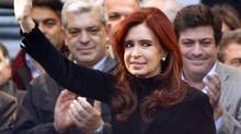 Argentine President Cristina Kirchner has vowed not to pay 'a single dollar' to holdout funds that Argentina terms vultures. That raises the possibility of default as early as next month. (Marcos Brindicci/REUTERS)