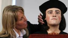 Philippa Langley, originator of the Looking for Richard project at a news conference in London Feb. 5, 2013, with a facial reconstruction of Richard III, based on bones found under a Leicester car park. (ANDREW WINNING/REUTERS)