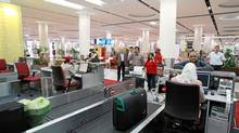 Emirates Airline passengers check-in at Dubai International Airport. (Gabriela Maj/Gabriela Maj/Bloomberg)
