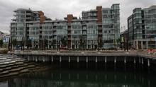 Numerous units sit empty as a woman jogs through the Millennium Water development which was the athletes' village during the 2010 Winter Olympics in Vancouver, B.C., on October 7, 2010. (Darryl Dyck/The Canadian Press)