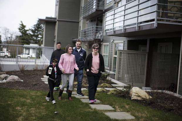 Tracie Sheppard, far right, hangs out with her friends outside their rental apartment in Surrey.