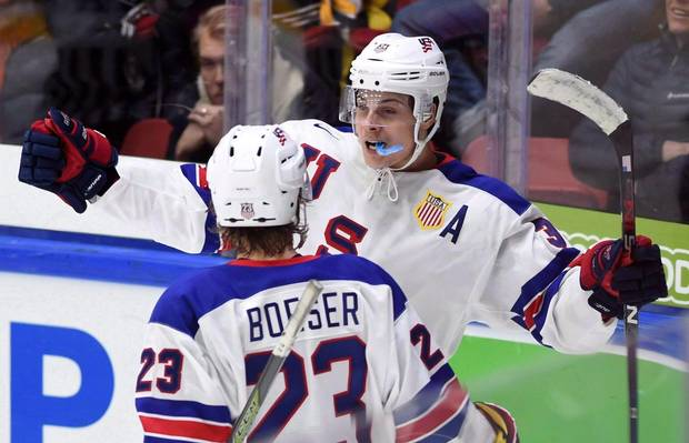 United States' Auston Matthews, back, celebrates a goal with teammate Brock Boeser during third period preliminary hockey action at the IIHF World Junior Championship in Helsinki, Finland, on Saturday, Dec. 26, 2015.