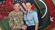 General David Petraeus shakes hands with author Paula Broadwell in this handout photo originally posted by the the International Security Assistance Force in Afghanistan in July 2011. (ISAF/REUTERS)