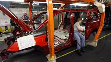 An assembly line at Chrysler's minivan plant in Windsor, Ont. (DAVE CHIDLEY)