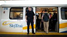 Constable Ken Rutland of the transit police patrols at the Commercial-Broadway Skytrain Station in Vancouver on Monday. (Rafal Gerszak for The Globe and Mail)
