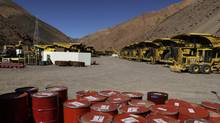 Mining machinery and barrels filled with chemicals sit on the facilities of Barrick's Pascua-Lama project, May 23, 2013. (JORGE SAENZ/AP)